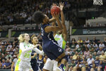 Connecticut's Christyn Williams (13) drives against South Florida defense, including Kristyna Brabencova (22), during the second half of an NCAA college basketball game Sunday, Feb. 16, 2020, in Tampa, Fla. (AP Photo/Mike Carlson)