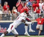 Mississippi Rebels wide receiver Elijah Moore (8) catches a pass against Arkansas Razorbacks defensive back Kamren Curl (2) at Vaught-Hemingway Stadium in Oxford, Miss. on Saturday, September 7, 2019. (Bruce Newman, Oxford Eagle via AP)/The Oxford Eagle via AP)/The Oxford Eagle via AP)