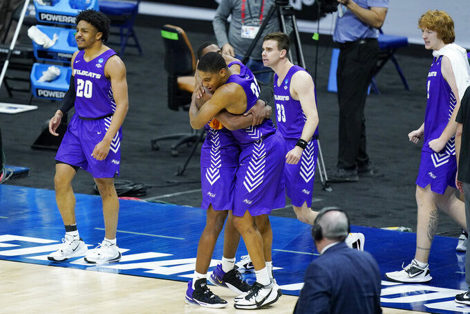 Abilene Christian players celebrate after upsetting Texas in a college basketball game in the first round of the NCAA tournament at Lucas Oil Stadium in Indianapolis Sunday, March 21, 2021. (AP Photo/Mark Humphrey)