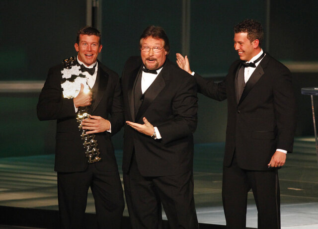 FILE - In this March 27, 2010, file photo, WWE Superstar Ted DiBiase Jr., left, with brother Brett DiBiase, right, induct their father