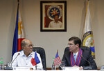 U.S. Defense Secretary Mark Esper, right, talks with his Philippine counterpart Delfin Lorenzana during a press conference at the Philippine Department of National Defense in Quezon city, metropolitan Manila, Philippines Tuesday, Nov. 19, 2019. Esper met with his Philippine counterpart to advance the alliance as well as strengthen regional security cooperation to uphold international rules and norms. (AP Photo/Aaron Favila)