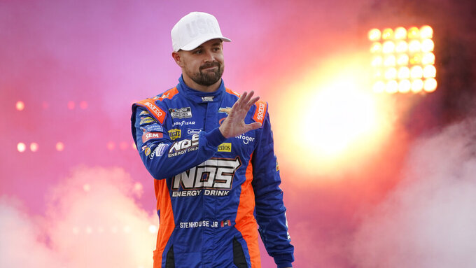 Ricky Stenhouse Jr. waves to the crowd during driver introductions prior to the start of the NASCAR Cup series auto race in Richmond, Va., Saturday, Sept. 11, 2021. (AP Photo/Steve Helber)