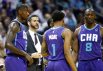 Charlotte Hornets coach James Borrego huddles with his team during a break in the first half of the team's NBA basketball game against the Boston Celtics in Charlotte, N.C., Thursday, Nov. 7, 2019. (AP Photo/Bob Leverone)