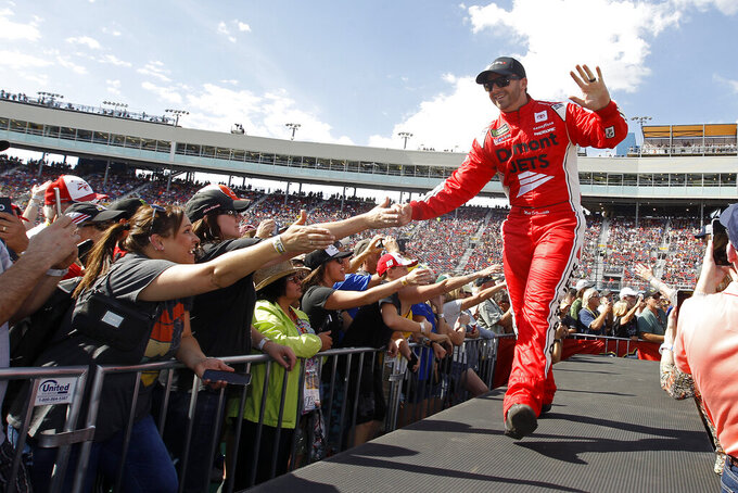 Matt DiBenedetto greets fans during driver introductions prior to the NASCAR Cup Series auto race at ISM Raceway, Sunday, Nov. 10, 2019, in Avondale, Ariz. (AP Photo/Ralph Freso)
