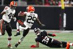 Cleveland Browns running back Demetric Felton (25) runs against Atlanta Falcons safety Jaylinn Hawkins (32) during the first half of a preseason NFL football game, Sunday, Aug. 29, 2021, in Atlanta. (AP Photo/Brynn Anderson)