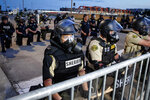 Police take their knees, uniting with protesters, in Des Moines, I.A. on Sunday, June 1, 2020. (Bryon Houlgrave /The Des Moines Register via AP )