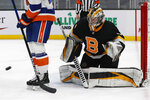 Boston Bruins goaltender Jeremy Swayman tracks a shot during the second period of the team's NHL hockey game against the New York Islanders on Friday, April 16, 2021, in Boston. (AP Photo/Winslow Townson)