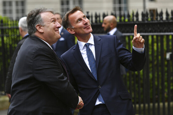 US Secretary of State Mike Pompeo, left, is greeted by Britain's Foreign Secretary Jeremy Hunt in central London, Wednesday May 8, 2019. U.S. Secretary of State Mike Pompeo is in London for talks with British officials on the status of the special relationship between the nations amid heightened tensions with Iran and uncertainty over Britain's exit from the European Union. (Mandel Ngan/Pool via AP)