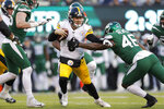 Pittsburgh Steelers quarterback Devlin Hodges (6) runs with the ball in front of New York Jets linebacker Neville Hewitt (46) in the second half of an NFL football game, Sunday, Dec. 22, 2019, in East Rutherford, N.J. (AP Photo/Adam Hunger)