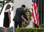 U.S. Defense Secretary Mark Esper with wife Leah, arranges a wreath during ceremonies at the Manila American Cemetery and Memorial in metropolitan Manila, Philippines Tuesday, Nov. 19, 2019. Esper is expected to meet with his Philippine counterpart to advance the alliance as well as strengthen regional security cooperation to uphold international rules and norms. (AP Photo/Aaron Favila)