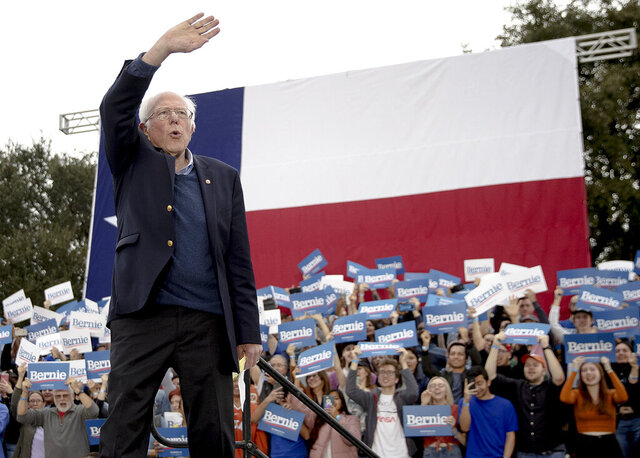 Democratic presidential candidate Sen. Bernie Sanders, I-Vt., waves to his supporters during a campaign event on Sunday, Feb. 23, 2020, in Austin, Texas. (Nick Wagner/Austin American-Statesman via AP)