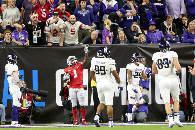 Ohio State wide receiver Johnnie Dixon (1) celebrates a touchdown reception during the second half of the Big Ten championship NCAA college football game against Northwestern, Saturday, Dec. 1, 2018, in Indianapolis. (AP Photo/AJ Mast)