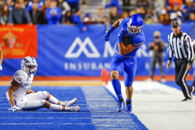Boise State's Riley Smith (3) stays in the field of play after recovering an onside kick, near Air Force's Jake Spiewak (11) during the second half of an NCAA college football game Saturday, Oct. 16, 2021, in Boise, Idaho. Air Force won 24-17. (AP Photo/Steve Conner)