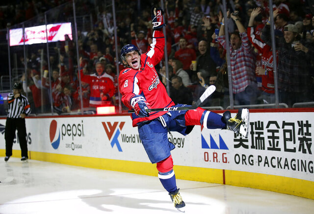 FILE- In this March 12, 2018, file photo, Washington Capitals left wing Alex Ovechkin celebrates his goal in the second period of an NHL hockey game against the Winnipeg Jets, Monday,, in Washington. It was Ovechkin's 600th career goal. Ovechkin is on the verge of becoming the eighth player in NHL history to score 700 career goals.  (AP Photo/Alex Brandon, File)