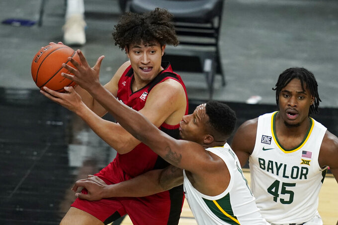 Louisiana-Lafayette's Brayan Au looks to pass the ball around Baylor's Mark Vital during the first half of an NCAA college basketball game Saturday, Nov. 28, 2020, in Las Vegas. (AP Photo/John Locher)