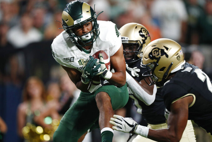 Colorado State wide receiver Dante Wright, left, pulls in a pass for a touchdown as Colorado safety Mikial Onu, front right, and cornerback Delrick Abrams Jr. cover in the first quarter of an NCAA college football game Friday, Aug. 30, 2019, in Denver. (AP Photo/David Zalubowski)