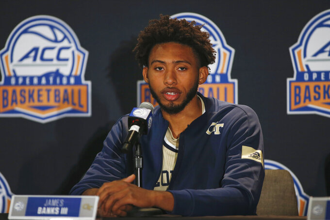 Georgia Tech basketball players James Banks III answers a question during the Atlantic Coast Conference NCAA college basketball media day in Charlotte, N.C., Tuesday, Oct. 8, 2019. (AP Photo/Nell Redmond)