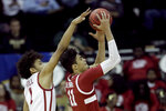Stanford forward Jaiden Delaire (11) shoots under pressure from Oklahoma forward Jalen Hill (1) during the first half of an NCAA college basketball game Monday, Nov. 25, 2019, in Kansas City, Mo. (AP Photo/Charlie Riedel)