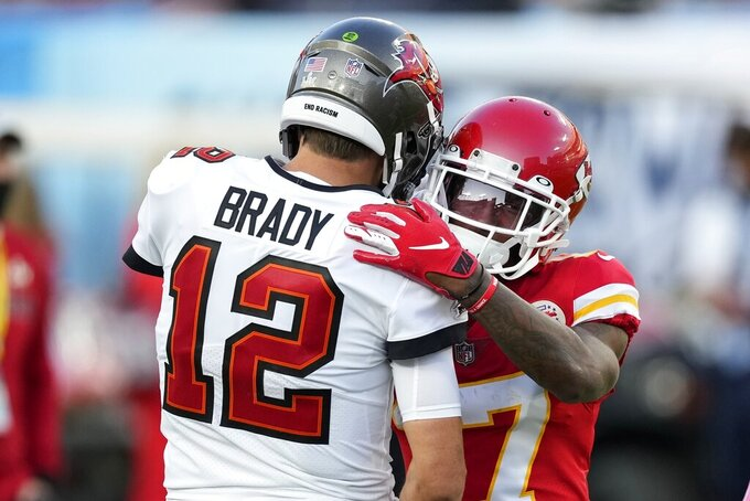 Tampa Bay Buccaneers quarterback Tom Brady (12) greets Kansas City Chiefs wide receiver Mecole Hardman before the NFL Super Bowl 55 football game between the Chiefs and Buccaneers, Sunday, Feb. 7, 2021, in Tampa, Fla. (AP Photo/Chris O'Meara)
