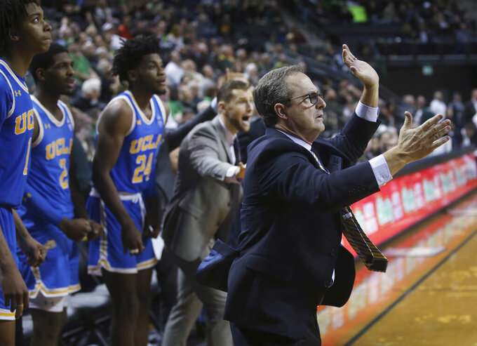 "FILE - In this Jan. 10, 2019, file photo, UCLA interim coach Murry Bartow, right, calls to his team in the closing seconds of regulation against Oregon in an NCAA college basketball game in Eugene, Ore. UCLA fired coach Steve Alford on New Year's Eve. Bartow was quickly tabbed as interim coach for the Bruins (10-7, 3-1 Pac-12). They've won three out of four games under him. ""We had a lot of ups and downs,"" UCLA freshman Moses Brown said, ""but I think we caught our stride and the sky is the limit for us."" (AP Photo/Chris Pietsch, File)"