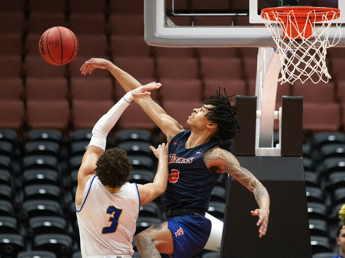 Cal State Fullerton guard Kyle Allman Jr., right, blocks the shot by UC Santa Barbara guard JaQuori McLaughlin during the second half of an NCAA college basketball game at the Big West men's tournament in Anaheim, Calif., Friday, March 15, 2019. (AP Photo/Kyusung Gong)