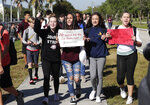 Students from Westglades Middle School walk out of their school as part of a nationwide protest against gun violence, Wednesday, March 14, 2018, in Parkland, Fla. Students across the country participate in walkouts Wednesday to protest gun violence, one month after the deadly shooting inside Marjory Stoneman Douglas High School in Parkland, Fla. (AP Photo/Lynne Sladky)