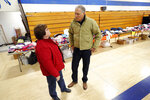 2020 Democratic presidential candidate Washington Gov. Jay Inslee talks with Sandra McKinnon, left, while visiting a flood service support center, Friday, April 12, 2019, in Hamburg, Iowa. (AP Photo/Charlie Neibergall)