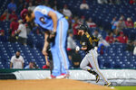 Pittsburgh Pirates' Colin Moran, right, rounds the bases past Philadelphia Phillies pitcher Aaron Nola after hitting a home run during the third inning of a baseball game, Thursday, Sept. 23, 2021, in Philadelphia. (AP Photo/Matt Slocum)
