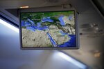 "FILE- In this Monday, Aug. 31, 2020 file photo, an overhead screen displays a map showing the flight route of an El Al plane from Israel en route to Abu Dhabi, United Arab Emirates. The Saudi Press Agency announced Wednesday, Sept. 2, 2020, that it will allow flights ""from all countries"" to cross its skies to reach the United Arab Emirates. The announcement comes just days after Saudi Arabia allowed the first direct Israeli commercial passenger flight to use its airspace to reach the UAE, signaling acquiescence for a breakthrough U.S.-brokered deal by the United Arab Emirates to normalize relations with Israel. (Nir Elias/Pool Photo via AP, File)"