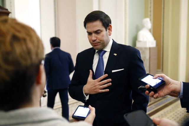 FILE - In this March 24, 2020, file photo, Sen. Marco Rubio, R-Fla., speaks with reporters on Capitol Hill in Washington. Rubio predicted in an interview with The Associated Press on Tuesday, May 26, that foreign actors will seek to amplify American conspiracy theories about the virus and find new ways to interfere in the 2020 presidential election, much as Russia did in 2016. (AP Photo/Patrick Semansky, File)