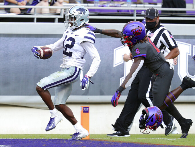 Kansas State defensive back AJ Parker (12) scores on an interception ahead of TCU running back Zach Evans (6) in the third quarter of an NCAA college football game Saturday, Oct. 10, 2020, in Fort Worth, Texas. (AP Photo/Richard W. Rodriguez)