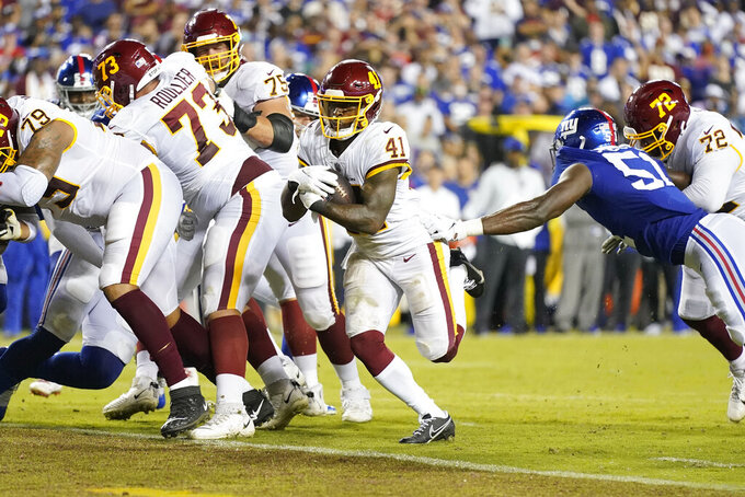 Washington Football Team running back J.D. McKissic (41) scores a touchdown against the New York Giants during the first half of an NFL football game, Thursday, Sept. 16, 2021, in Landover, Md. (AP Photo/Patrick Semansky)