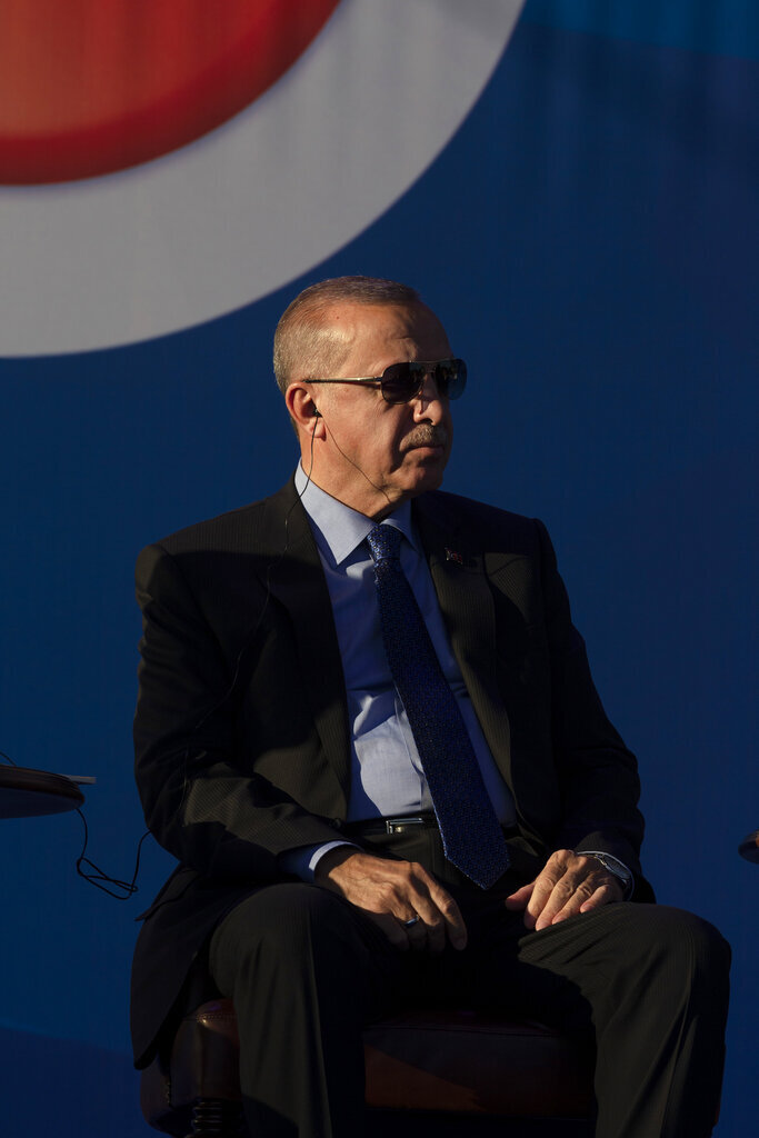 Recep Tayyip Erdogan, the president of Turkey, sits on a stage during a ceremony in Sremska Raca, some 80 kolometers west of Belgrade, Serbia, Tuesday, Oct. 8, 2019. Erdogan attended a ceremony inaugurating a Turkey-financed highway linking Belgrade with Bosnia's capital of Sarajevo that is part of efforts to boost cooperation between former wartime foes. (AP Photo/Marko Drobnjakovic)