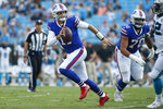 Buffalo Bills quarterback Josh Allen (17) runs out of the pocket against the Carolina Panthers during the first half an NFL preseason football game, Friday, Aug. 16, 2019, in Charlotte, N.C. (AP Photo/Brian Blanco)