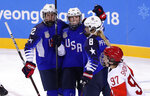 Jocelyne Lamoureux-Davidson, center, celebrates with Kelly Pannek, left, and Emily Pfalzer, of the United States, after scoring a goal during the second period of the preliminary round of the women's hockey game at the 2018 Winter Olympics in Gangneung, South Korea, Tuesday, Feb. 13, 2018. (AP Photo/Frank Franklin II)