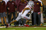Ohio State wide receiver Chris Olave (2) runs for a receiving touchdown against Minnesota during the third quarter of an NCAA college football game Thursday, Sept. 2, 2021, in Minneapolis. Ohio State won 45-31. (AP Photo/Bruce Kluckhohn)
