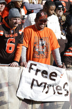 Cleveland Browns fans hold up a sign to free Cleveland Browns defensive end Myles Garrett during the first half of an NFL football game against the Miami Dolphins, Sunday, Nov. 24, 2019, in Cleveland. (AP Photo/Ron Schwane)