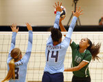 """FILE - Reagan's Kyla Waiters, right, spikes the ball past Johnson defenders during a Texas District 26-6A high school volleyball match in San Antonio, Texas, in this Friday, Sept. 22, 2017, file photo. Oregon State leaders are suing to block disclosure of details about an investigation of abuse allegations in their volleyball program, even as they tout a refreshed mission for transparency in wake of their president's resignation over the handling of sexual-misconduct cases at another school. """"I'm guessing there's something in those records that they don't want out,"""" said Dorina Waiters, whose daughter, Kyla, left Oregon State after a year on the volleyball team triggered depression that led to suicidal thoughts.  (Ron Cortes/The San Antonio Express-News via AP, File)"""