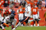 Chicago Bears kicker Eddy Pineiro (15) kicks the game-winning field goal as punter Pat O'Donnell (16) holds during the second half of an NFL football game against the Denver Broncos, Sunday, Sept. 15, 2019, in Denver. The Bears won 16-14. (AP Photo/David Zalubowski)