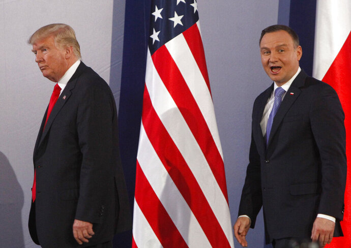 File -- In this Thursday, July 6, 2017 file photo U.S. President Donald Trump, left, and Poland's President Andrzej Duda, leave at the end of a joint press conference, in Warsaw, Poland. Trump and Duda will meet at the White House on June 24, four days ahead of a presidential election in Poland in which Duda, a conservative, is seeking reelection. The meeting is expected to give Duda a boost, and is seen by some as election interference. (AP Photo/Czarek Sokolowski/file)