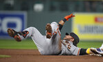 San Francisco Giants' Brandon Crawford slides into second base with a double off Colorado Rockies relief pitcher Ashton Goudeau during the third inning of a baseball game Tuesday, Sept. 7, 2021, in Denver. (AP Photo/David Zalubowski)