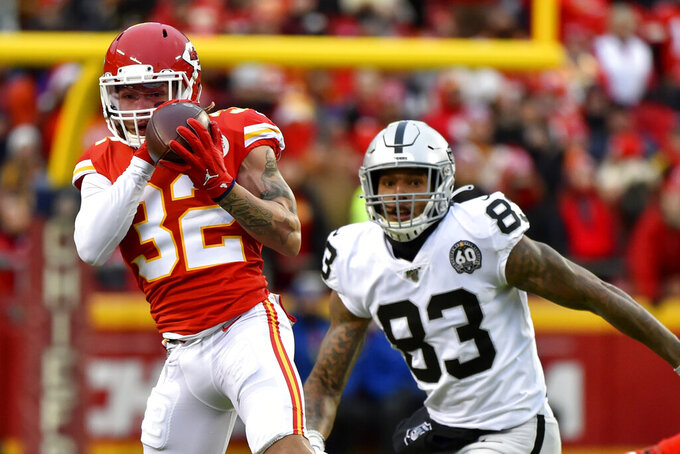 Kansas City Chiefs safety Tyrann Mathieu (32) intercepts a pass intended for Oakland Raiders tight end Darren Waller (83) during the first half of an NFL football game in Kansas City, Mo., Sunday, Dec. 1, 2019. (AP Photo/Ed Zurga)