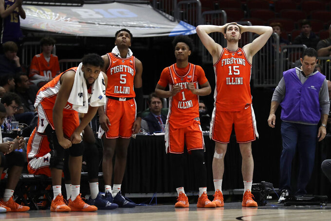 Illinois's Adonis De La Rosa (12), Tevian Jones (5), Trent Frazier (1) and Giorgi Bezhanishvili (15) react on the bench during the second half of an NCAA college basketball game against the Iowa in the second round of the Big Ten Conference tournament, Thursday, March 14, 2019, in Chicago. Iowa won 83-62. (AP Photo/Nam Y. Huh)
