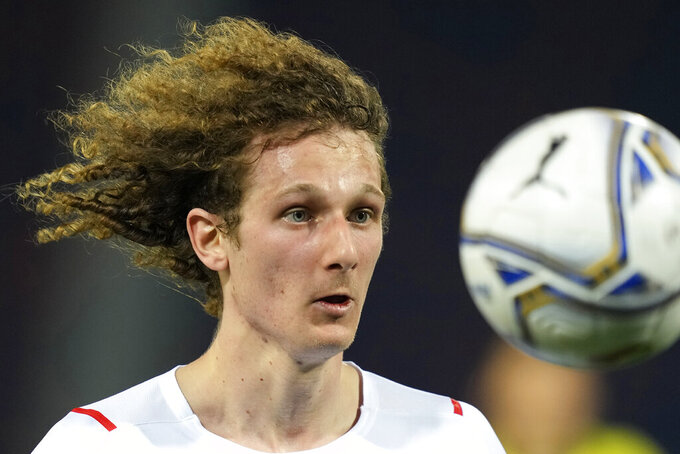 Czech Republic's Alex Kral eyes the ball during the international friendly soccer match between Italy and Czech Republic in Bologna, Italy, Friday, June 4, 2021. (AP Photo/Antonio Calanni)