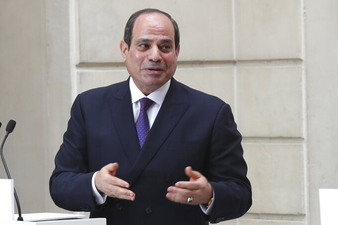 FILE - In this Dec. 7, 2020, file photo, Egyptian President Abdel-Fattah el-Sissi speaks during a joint press conference with French President Emmanuel Macron at the Elysee palace, Monday, Dec. 7, 2020 in Paris.  Egypt's President Abdel Fattah el-Sissi has given his support to a transitional government that would lead neighboring Libya through elections late this year. (AP Photo/Michel Euler, File)