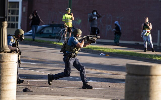Police take control of the area near the Super Target against protesters Thursday, May 28, 2020, in St. Paul, Minn. Protests over the death of George Floyd, a black man who died in police custody, broke out in Minneapolis for a third straight night. (Richard Tsong-Taatarii/Star Tribune via AP)