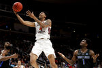 Virginia Tech guard Nickeil Alexander-Walker scores past Saint Louis forward D.J. Foreman, right, during the first half of a first-round game in the NCAA men's college basketball tournament Friday, March 22, 2019, in San Jose, Calif. (AP Photo/Jeff Chiu)