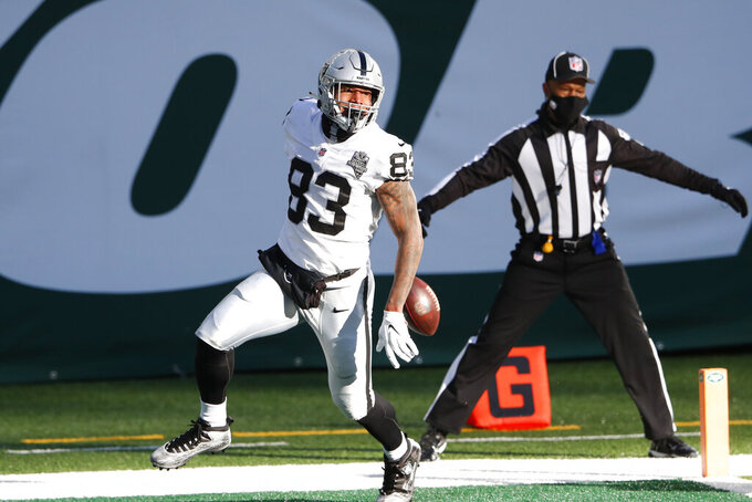 Las Vegas Raiders' Darren Waller celebrates his touchdown during the first half an NFL football game against the New York Jets, Sunday, Dec. 6, 2020, in East Rutherford, N.J. (AP Photo/Noah K. Murray)