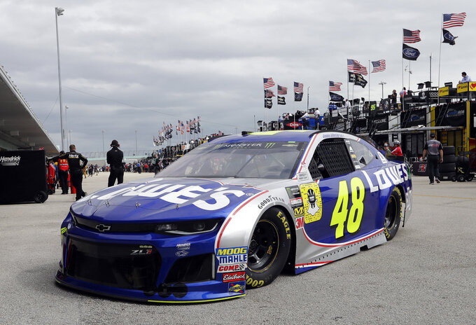 Jimmie Johnson (48) leaves the garage during practice for the NASCAR Cup Series auto race at the Homestead-Miami Speedway, Saturday, Nov. 17, 2018, in Homestead, Fla. (AP Photo/Lynne Sladky)