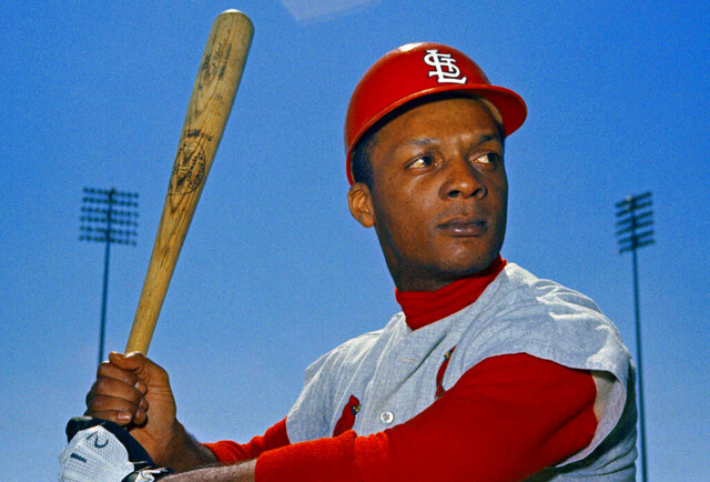 File-This 1968 file photo shows St. Louis Cardinals outfielder Curt Flood. Flood set off the free-agent revolution 50 years ago Tuesday, Dec. 24, 2019, with a 128-word  letter to baseball Commissioner Bowie Kuhn, two paragraphs that pretty much ended the career of a World Series champion regarded as among the sport's stars but united a union behind his cause. (AP Photo/File)